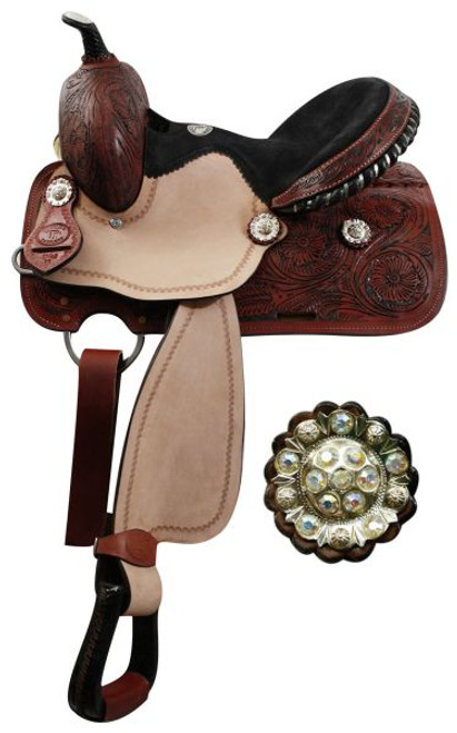 "13"" Youth Double T barrel saddle with fully tooled pommel, skirts and cantle. Saddle features crystal rhinestone conchos, roughout fenders and jockies, rawhide braided horn, and a black suede seat with a black rawhide cantle with silver inlay. Saddle features inskirt rigging and close contact skirts. Comes with a leather latigo tie strap and off billet."