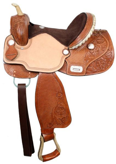 Double T barrel saddle with flex tree. Saddle features floral and basketweave tooling on skirts, fenders, cantle and pommel. . Saddle has inskirt rigging, roughout jockies and suede leather seat. Made by Double T Saddlery.