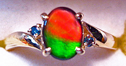 Korite Ammolite Oval Ring w/Blue Diamond Accents 8KGR