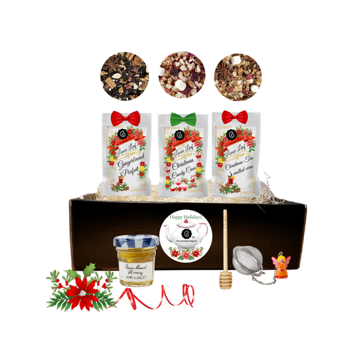 Christmas Angel Tea Collection -Gift Set: Three Christmas teas for an extra joyous gift this season comes ready to use with angel tea ball, mini honey and honey spool.  Decorative seasonal tea packaging and accessories come nestled in a reusable gift tray with raffia fill, shrink wrapped and a red raffia hand tied bow. A gift enclosure card with a 10% off coupon for your recipient on their first purchase of tea.  Cornucopia provides the highest quality teas sourced from plantations around the world.      Includes:  3-1 oz. 12 cups Cornucopia Christmas Tea favorites, Gingerbread Parfait, Candy Cane, Christmas Mulled Wine  Candy Cane: We have captured the unmistakable taste of this well-loved candy in this unique tea blend, underlining it with an intense sweetness and rounding it off with a touch of peppermint. The bright red currants are a real eye-catcher and deliver a perfect performance.  Ingredients: apple pieces, pineapple cubes (pineapple, sugar), natural flavoring, marshmallows (glucose-fructose syrup, sugar, water, gelatin, corn starch, natural flavoring), whole star aniseed, freeze-dried whole red currants, peppermint, pink cornflower blossoms. Mulled Wine: This tea blend is a real taste explosion thanks to the exceptional flavor composition of the incredibly unique German version. What makes this blend so special: the traditional flamed cone sugar, which slowly melts into delicious caramel.  Pure exaltation!  Ingredients: apple pieces, hibiscus blossoms, elderberries, rose hip peel, Mistletoe, cinnamon rods, flavoring celery seed oil, orange slices, cloves. Gingerbread Parfait: Black tea Spicy, sweet gingerbread and fruity, lively mandarins are a must for anyone who loves the enticing scents of wintry spices and Christmas preparations. Ingredients: (43%), apple pieces, half-fermented tea (8%), flavoring, cinnamon pieces, freeze-dried yoghurt granules (skimmed milk yogurt, sugar, maltodextrin, modified starch, acidifying agent: citric acid), sliced almonds, mandarin sections, whole star aniseed, cardamom (whole), cinnamon rods, Contains almond and milk   1- Mini 1 oz. Bonne Maman Honey  1 Honey spool  1 Angel Tea ball, made in Germany by Cha Cult  Cornucopia Teas come in resealable pouches with decorative tea labels and includes a recipe and brewing guide. If purchasing as a gift, your personal message is included on the pamphlet.