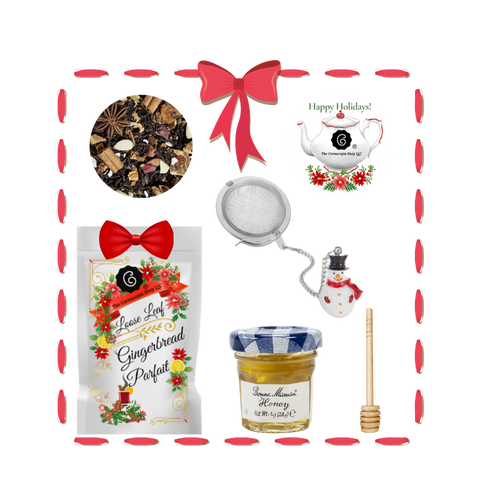 Santa's Tea Shop - Gingerbread Parfait Gift Basket: Special Buy Free Shipping  This gift basket comes ready to use with a snowman tea ball, mini honey and honey spool. A wonderful time to experience Cornucopia's organic, loose leaf teas.  This gift enclosure card includes a 10% off coupon for your recipient to uese towards their first purchase of tea.   Includes:  1-1 oz. 12 cups Gingerbread Parfait, a Cornucopia Christmas Kitchen Tea favorite : Black tea Spicy, sweet gingerbread and fruity, lively mandarins are a must for anyone who loves the enticing scents of wintry spices and Christmas preparations. Ingredients: (43%), apple pieces, half-fermented tea (8%), flavoring, cinnamon pieces, freeze-dried yoghurt granules (skimmed milk yogurt, sugar, maltodextrin, modified starch, acidifying agent: citric acid), sliced almonds, mandarin sections, whole star aniseed, cardamom (whole), cinnamon rods, Contains almond and milk   1- Mini 1 oz. Bonne Maman Honey  1 Honey spool  1 Snowman Tea ball, made in Germany by Cha Cult  Cornucopia Teas are of the highest quality and sourced from plantations around the world.  Our teas come in resealable pouches with decorative tea labels and includes a recipe and brewing guide.  Your personal message is included on the pamphlet as your enclosure card.  Gift comes shrink wrapped in reusable tray and decorative bow.