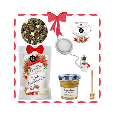 Santa's Tea Shop - White Christmas Gift Basket: Special Buy Free Shipping  This gift basket comes ready to use with a snowman tea ball, mini honey and honey spool. A wonderful time to experience Cornucopia's organic, loose leaf teas.  This gift enclosure card includes a 10% off coupon for your recipient to uese towards their first purchase of tea.   Includes:  1-1 oz. 12 cups White Christmas - Green tea blend, flavored Chocolate, Pear, Ginger Cake a Cornucopia Christmas Kitchen, Tea favorite: The scent of ripe pears, butter, sugar, and sweet chocolate chips all baked together in a mouthwatering cake are bound to awaken the festive spirit. Cocoa peel and candied ginger bits add a sweet, spicy twist to this green tea blend.  Ingredients: Green tea (50 %), cocoa peel, ginger cubes (sugar, ginger, acidifying agent: citric acid), pear pieces, ginger pieces, flavoring, freeze-dried pear pieces 1- Mini 1 oz. Bonne Maman Honey  1 Honey spool  1 Angel Tea ball, made in Germany by Cha Cult  Cornucopia Teas are of the highest quality and sourced from plantations around the world.  Our teas come in resealable pouches with decorative tea labels and includes a recipe and brewing guide.  Your personal message is included on the pamphlet as your enclosure card.  Gift comes shrink wrapped in reusable tray and decorative bow.
