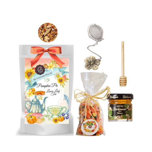 """Harvest Tea Gift Basket-Pumpkin Pie Fruit Tea  Limited Edition by The Cornucopia's Tea Shop. Seasonal Label is a fun way to enjoy a fall tea favorite, with everything needed to make a loose leaf brew. A sip of tea and a nibble of candy just what the day ordered!  Gift includes:  1 oz. Pumpkin Pie Fruit Tea ( Loose Leaf )Ingredients:pumpkin cubes, apple pieces, cinnamon pieces, ginger cubes (sugar, ginger, acidifying agent: citric acid), turmeric roots, cinnamon rods, cloves, cardamom (whole), pink pepper, natural flavoring. 1- 2"""" Tea Ball with fall flower, stainless steel Dickinson's Mini Honey 1 oz. Honey Spool wooden 7 oz Autumn Pumpkin mix Candy Corn with chocolate candy corn, original candy corn and pumpkins, gift pack with natural rafia hand tied bow.  Gift comes in a shrink wrapped tray with natural raffia hand tied bow and gift card with brewing guide, 10% off next tea purchase, and your personalized gift message."""