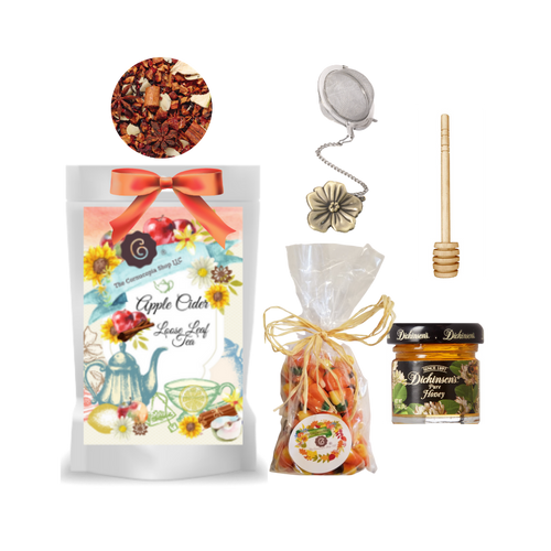 """Harvest Tea Gift Basket-Autumn Apple Cider Furit Tea  Limited Edition by The Cornucopia's Tea Shop. Seasonal Label is a fun way to enjoy a fall tea favorite, with everything needed to make a loose leaf brew. A sip of tea and a nibble of candy just what the day ordered!  Gift includes:  1 oz. Autumn Apple Cider Fruit Tea ( Loose Leaf ) Ingredients: apple pieces, cinnamon rods, hibiscus blossoms, apple slices, sliced almonds, rose hip peel, elderberries, currants, whole star aniseed, natural flavoring, cinnamon pieces. 1- 2"""" Tea Ball with fall flower charm, stainless steel Dickinson's Mini Honey 1 oz. Honey Spool wooden 7 oz Autumn Pumpkin mix Candy Corn with chocolate candy corn, original candy corn and pumpkins, gift pack with natural rafia hand tied bow.  Gift comes in a shrink wrapped gift tray with natural raffia hand tied bow and gift card with brewing guide, 10% off next tea purchase, and your personalized gift message."""