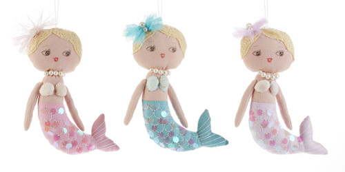 "9"" Hanging Shimmer Mermaid Decor Doll: Perfect decor for the little girl, or anyone who loves Mermaids. They come in three different colors with a pearl neclace, shell and netting top, and sequine dress. Lots of little details on the cloth body, hand stiched trims  lace hair, a matching hair bow with pearl accent. Buy all three to hang as a set in her bedroom.    Includes: 1-9"" hanging decor cloth doll of color choice.     Pink, Blue, Lavender, Note: not a toy, decor use only."