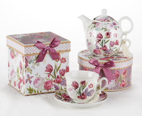 """Tulip Tea for one set in gift box, will brighten anyone's day with this beautiful tea for one gift set in its own matching print gift box with matching satin ribbon. A decorative tassel on the handle adds a lovely touch. Gifting Idea: birthday gift, bridal shower, get well, thank you or treat yourself. Holds enough for a refill without leaving your comfy spot, desk or sip at beside for an evening nightcap.  Includes:  5.8"""" Tea for One Set in gift box Stacked teapot and oversized teacup Soft white background with a Tulip floral print Dishwasher safe  Other Items Available:  Tea choices available to add to your order in the loose-leaf shop  Teas and Teaware are shipped together, Cornucopia Teas come in resealable pouches with decorative tea labels, and includes a recipe and brewing guide. If purchasing as a gift your personal message is included on the gift card-  Cup and saucer not included."""