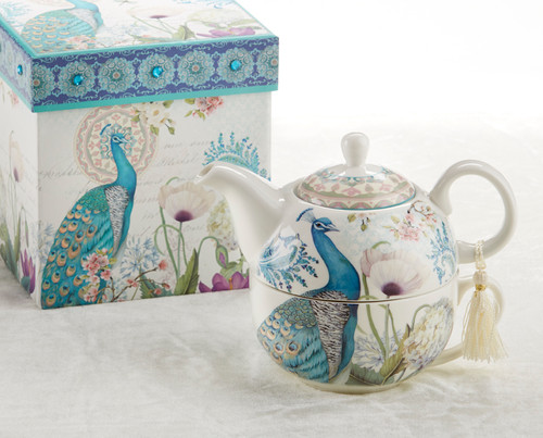 """Peacock Tea for one set in gift box, will brighten anyone's day with this beautiful tea for one gift set in its own matching print gift box with matching satin ribbon. A decorative tassel on the handle adds a lovely touch. Gifting Idea: birthday gift, bridal shower, get well, thank you or treat yourself. Holds enough for a refill without leaving your comfy spot, desk or sip at beside for an evening nightcap.  Includes:  5.8"""" Tea for One Set in gift box Stacked teapot and oversized teacup Soft white background in hughes of royal blue and teal Peacock print Dishwasher safe  Other Items Available:  Tea choices available to add to your order in the loose-leaf shop  Teas and Teaware are shipped together, Cornucopia Teas come in resealable pouches with decorative tea labels, and includes a brewing guide.  If purchasing as a gift your personal message is included on the gift card"""