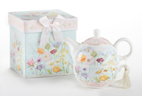 """Wildflower Tea for one set in gift box, will brighten anyone's day with this beautiful tea for one gift set in its own matching print gift box with matching satin ribbon. A decorative tassel on the handle adds a lovely touch. Gifting Idea: birthday gift, bridal shower, get well, thank you or treat yourself. Holds enough for a refill without leaving your comfy spot, desk or sip at beside for an evening nightcap.  Includes:  5.8"""" Tea for One Set in gift box Stacked teapot and oversized teacup Soft white and blue background with a pastel floral print Dishwasher safe  Other Items Available:  Tea choices available to add to your order in the loose-leaf shop  Teas and Teaware are shipped together, Cornucopia Teas come in resealable pouches with decorative tea labels, and includes a brewing guide. If purchasing as a gift your personal message is included on the gift card"""