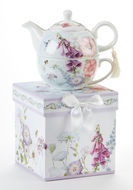 """Bell Isle Tea for one set in gift box, will brighten anyone's day with this beautiful tea for one gift set in its own matching print gift box with matching satin ribbon. A decorative tassel on the handle adds a lovely touch. Gifting Idea: birthday gift, bridal shower, get well, thank you or treat yourself. Holds enough for a refill without leaving your comfy spot, desk or sip at beside for an evening nightcap.  Includes:  5.8"""" Tea for One Set in gift box Stacked teapot and oversized teacup Soft white and blue background with a floral print Dishwasher safe  Other Items Available:  Tea choices available to add to your order in the loose-leaf shop  Teas and Teaware are shipped together, Cornucopia Teas come in resealable pouches with decorative tea labels, and includes a brewing guide. If purchasing as a gift your personal message is included on the gift card"""