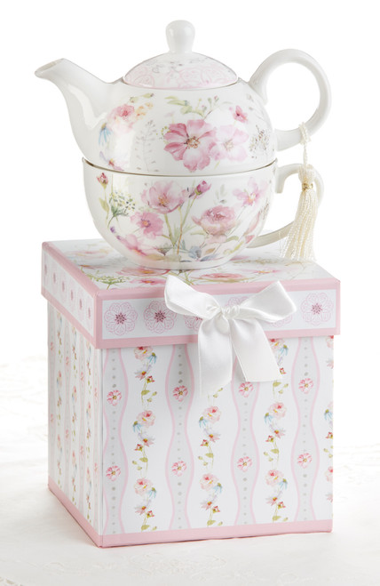 """Poppyseed Tea for one set in gift box, will brighten anyone's day with this beautiful tea for one gift set in its own matching print gift box with matching satin ribbon. A decorative tassel on the handle adds a lovely touch. Gifting Idea: birthday gift, bridal shower, get well, thank you or treat yourself. Holds enough for a refill without leaving your comfy spot, desk or sip at beside for an evening nightcap.  Includes:  5.8"""" Tea for One Set in gift box Stacked teapot and oversized teacup Soft white background with a pink foral print Dishwasher safe  Other Items Available:  Tea choices available to add to your order in the loose-leaf shop  Teas and Teaware are shipped together, Cornucopia Teas come in resealable pouches with decorative tea labels, and includes a brewing guide. If purchasing as a gift your personal message is included on the gift card"""