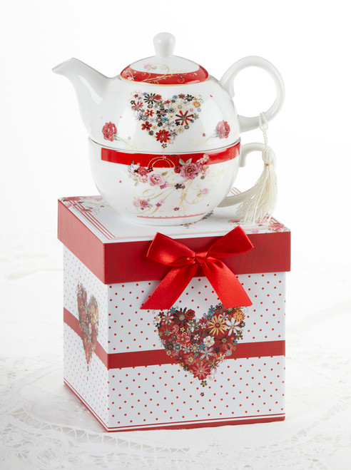 """Floral Heart Tea for one set in gift box, will brighten anyone's day with this beautiful tea for one gift set in its own matching print gift box with matching satin ribbon. A decorative tassel on the handle adds a lovely touch. Gifting Idea: birthday gift, bridal shower, get well, thank you or treat yourself. Holds enough for a refill without leaving your comfy spot, desk or sip at beside for an evening nightcap.  Includes:  5.8"""" Tea for One Set in gift box Stacked teapot and oversized teacup Soft white background with a red foral print Dishwasher safe  Other Items Available:  Tea choices available to add to your order in the loose-leaf shop  Teas and Teaware are shipped together, Cornucopia Teas come in resealable pouches with decorative tea labels, and includes a brewing guide. If purchasing as a gift your personal message is included on the gift card"""