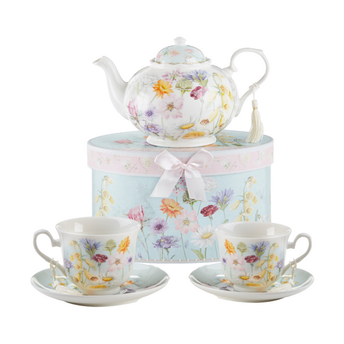 """Wildflower Tea Set, will brighten anyone's day with this beautiful tea set in its own matching print gift box with matching satin ribbon. A decorative tassel on the handle adds a lovely finishing touch. Gifting Idea: birthday gift, bridal shower, get well, treat yourself or someone you love.  Includes:  9.5 x 5.6"""" teapot 2 cup/saucer Soft white and blue background with a pastel floral print Dishwasher safe  Tea choices available to add to your order in the loose-leaf shop  Teas and Teaware are shipped together, Cornucopia Teas come in resealable pouches with decorative tea labels, and includes a recipe and brewing guide. If purchasing as a gift your personal message is included on the pamphlet."""