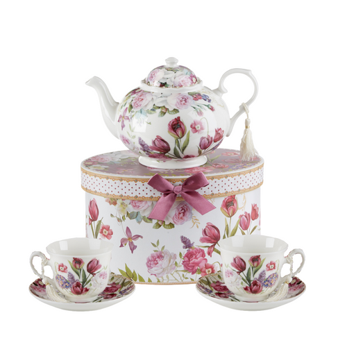 """Tulip Tea Set, will brighten anyone's day with this beautiful tea set in its own matching print gift box with matching satin ribbon. A decorative tassel on the handle adds a lovely finishing touch. Gifting Idea: birthday gift, bridal shower, get well, treat yourself or someone you love.  Includes:  9.5 x 5.6"""" teapot 2 cup/saucer Soft white background with a purple tulip floral print Dishwasher safe  Tea choices available to add to your order in the loose-leaf shop  Teas and Teaware are shipped together, Cornucopia Teas come in resealable pouches with decorative tea labels, and includes a brewing guide. If purchasing as a gift your personal message is included on the pamphlet."""