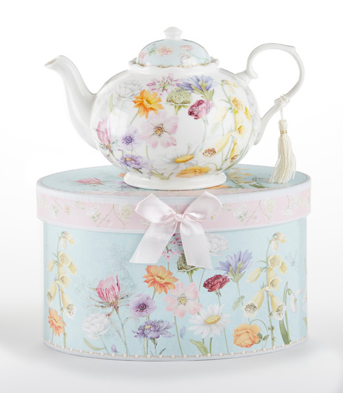 """Wildflower Teapot in gift box, will brighten anyone's day with this beautiful teapot gift in its own matching print gift box with matching satin ribbon. A decorative tassel on the handle adds a lovely finishing touch. Gifting Idea: birthday gift, bridal shower, get well, treat yourself or someone you love.  Includes:  9.5 x 5.6"""" teapot Soft white and blue background with a pastel floral print Dishwasher safe  Other Items Available:  Tea choices available to add to your order in the loose-leaf shop  Teas and Teaware are shipped together, Cornucopia Teas come in resealable pouches with decorative tea labels, and includes a brewing guide. If purchasing as a gift your personal message is included on the pamphlet."""