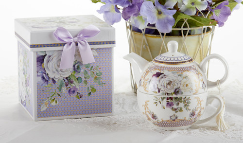 """Purple Elegance Tea for One in Gift Box, will brighten anyone's day with this beautiful tea for one gift set in its own matching print gift box with matching satin ribbon. A decorative tassel on the handle adds a lovely touch. Gifting Idea: birthday gift, bridal shower, get well, thank you or treat yourself. Holds enough for a refill without leaving your comfy spot, desk or sip at bedside for an evening nightcap.  Includes:  5.8"""" Tea for One Set in gift box Stacked teapot and oversized teacup Soft white background in hughes of purple an whitle floral print Dishwasher safe  Other Items Available:  Tea choices available to add to your order in the loose-leaf shop  Teas and Teaware are shipped together, Cornucopia Teas come in resealable pouches with decorative tea labels, and includes a brewing guide. If purchasing as a gift your personal message is included on the gift card"""