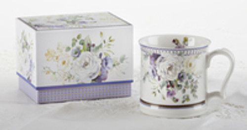 """Milk Mug Purple Elegance in Gift Box, This jumbo mug is great for any beverage choice and will brighten anyone's day in its own matching print gift box with matching satin ribbon. Gifting Idea: birthday gift, bridal shower, get well, treat yourself or someone you love.  Includes:  4.2"""" Mug in gift box Soft white background with a purple and white Floral print with gold accents Dishwasher safe  Other Items Available:  Tea choices available to add to your order in the loose-leaf shop Teas and Teaware are shipped together, Cornucopia Teas come in resealable pouches with decorative tea labels, and includes a recipe and brewing guide. If purchasing as a gift your personal message is included on the pamphlet."""