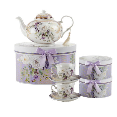 "Purple Elegance Tea Set, will brighten anyone's day with this beautiful tea set in its own matching print gift box with matching satin ribbon. A decorative tassel on the handle adds a lovely finishing touch. Gifting Idea: birthday gift, bridal shower, get well, treat yourself or someone you love.   Includes:  9.5 x 5.6"" teapot  2 cup/saucer Soft white background with a purple and whie floral print with gold accents Dishwasher safe  Tea choices available to add to your order in the loose-leaf shop   Teas and Teaware are shipped together, Cornucopia Teas come in resealable pouches with decorative tea labels, and includes a brewing guide. If purchasing as a gift your personal message is included on the pamphlet."