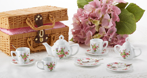 Toy Porcelain Tea Set in Basket-Multi Daisy It's a tea party set for two!  Mixed daisy print tea set in a Honey Brown picnic basket chest with Pink check cloth liner. Perfect activity set for any little girl. By Delton ages 5+  1-Teapot, 2-Cup and Saucer, 2-Serving plates, 2 each, Spoon and Fork, 1-Storage Picnic basket.  This set is part of the Cornucopia's Toy Tea party set and comes with additional add ons:  Perfect tea party companion doll by Apple Dumplin Dolls 1 oz (12 tea parties or more) Children's Tea available There is hardly another fruit on this planet which is as popular among young and old as the strawberry. We are, therefore, presenting our particular, decaffeinated, flavored green tea variation. Its mild and, at the same time, intense taste is due to a natural strawberry flavoring, which shines when interacting with the soft tea basis. Ingredients: decaffeinated green tea, freeze-dried strawberry pieces, natural flavoring type strawberry. All choices are shipped together in one box. Gift card enclosure