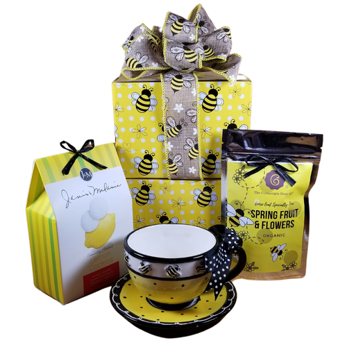 """This little Bizzie Bee Teacup and Saucer with Tea Gift Box, is a sweet way to send your best wishes, thank you, get well, or habee brithday!  Includes:  Bizzie Bee Teacup and Saucer comes with a black polka dot bow on the handle, Dishwasher safe/FDA approved/Microwave safe. Hand-painted ceramic. Holds 8 oz. 1 oz Spring Fruit and Flowers 7T6358 J & M Lemon Tea Cookies delicate powdered sugared lemony treat. Perfect with a cup of tea.  This gift comes in a matching gift box, tea label and hand made bow. Completed gift measures 10"""" long by 10"""" wide and 3"""" tall and weighs 2 pounds.  A Bizze Bee Gift Card to fill out your personal message and is tucked inside your gift."""