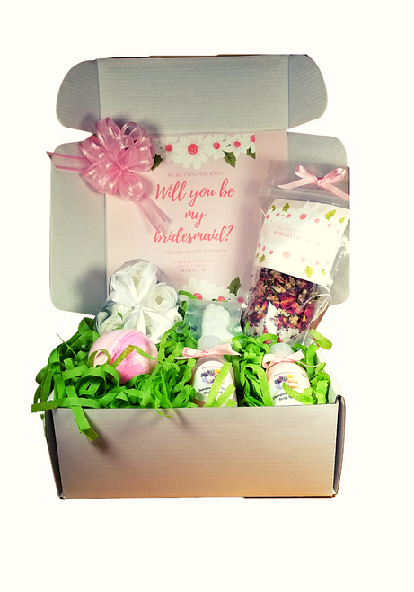 Will You Be My Bridal Boxes - Ladies - Personalized - will you be my Bridesmaid or Maid of Honor Spa gift with personalized label on the inner box flap with their name, your wedding information.  Gift includes Champagne & Roses body lotion, body wash, Rose Petal Bath Soak, Rose bath bomb, Bride & Groom mini soap, Rose soaps in heart shaped gift box.  Gift includes: Rose Spa collection •Champagne and Roses Body Lotion 3 oz.,  •Champagne and Roses Body Wash 3 oz.,  •Rose Bath Salts 2 oz., •Sugar Rose Bath Bomb 5 oz,   •Rose Bud Soaps in clear heart shaped box with white bow,  •Mini Bride and Groom soap, white. •Bow upper left corner of box •Enclosure card with additional information max 500 characters to allow a personal message to your potential Bridesmaid or Maid of Honor (optional) •Box is tucked close and tied up with a white satin bow  •Gift is shipped in shipping box Ordering policy for this item: •Cancellations and refunds on personalized items is not available. •Please be certain all your personal information, wedding dates, recipients name are correct. •Allow 4 - 5 weeks for delivery.  Processing and Shipping Kindly make sure of he following: •Shipping information is correct, Please note: there are additional charges by UPS or USPS for address corrections. •Do not ship to a business addresses, residential addresses only. •Rush orders contact us for assistance. 331-212-6087 or use our contact us form.  •As a busy Bride to be, we personally track all orders and notify you when each recipient's delivery is complete.  Be sure to enter your email and phone number on your order for this purpose.   We wish you the best as you plan your wedding day!