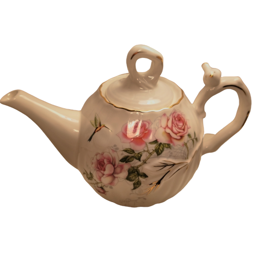 Humming Bird Teapot: 16 oz. by Kent pottery Teapot, Porcelain, White with Humming Bird and Rose floral print in shades of pink with gold trim.  Dishwasher and microwave safe.