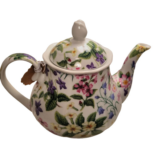 Botanical Teapot: 16 oz. by Kent pottery. Porcelain, white with botanical floral print in shades of green, white, pink and yellow. Dishwasher and microwave safe.
