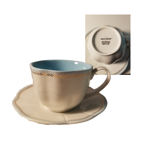 "Grace Teaware Cup/Saucer   White with gold and blue trim, blue on inside of cup.  Porcelain   Includes:  3.5"" Cup/Saucer  Dishwasher and microwave safe"