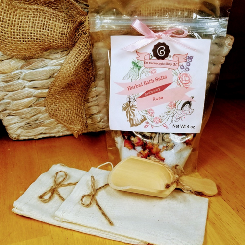 Rose Bath Salts: An aromatherapy spa time with a bouquet of a roses from the Egyptian gardens first blooms, essential oils, and bath salts. The cares of the day will melt away. No added dyes.  Includes:  1- 4 oz Rose Bath Salts Bath Salt:  Ingredients: Organic Super Egyptian Rose Buds and petals, Epsom Salts, Rose Flower Essential Oil   accessories not included