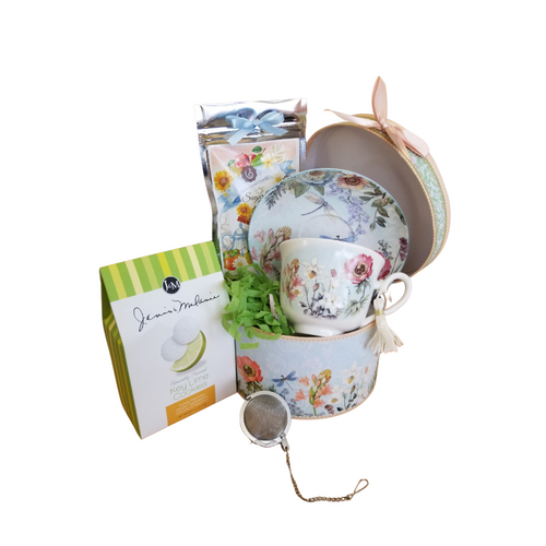 """Hat Box Gift Basket - Cup/Saucer. This pretty set comes packaged in it's own matching pattern hat box with decorative satin bow, loose leaf tea, tea ball, and tea cookie. The decorative box can be used in so many ways or to store the set in. Choose your tea cup pattern from the options listed. Image shown is the Dragon Fly pattern. Each set comes with it's own matching cookie of either lemon, raspberry or lime with a matching tea. Gift is shrink wrapped and includes a complimentary gift card with your personal message tucked inside the shipping box.  Gifting Idea: birthday gift, bridal shower, get well, Administrative Professionals day, Thank you gift, Bridesmaid gifts.   Includes:  3.5"""" Cup/Saucer in gift boxits own matching print gift box with matching satin ribbon. A decorative tassel on the handle adds a lovely finishing touch, dishwasher safe. 1 oz of Cornucopia's Loose Leaf Tea 2.5 oz J & M's Gourmet Tea Cookie in either Raspberry, Lemon, or Lime 1 """" Tea ball infuser stainless steel by Chai Cult."""