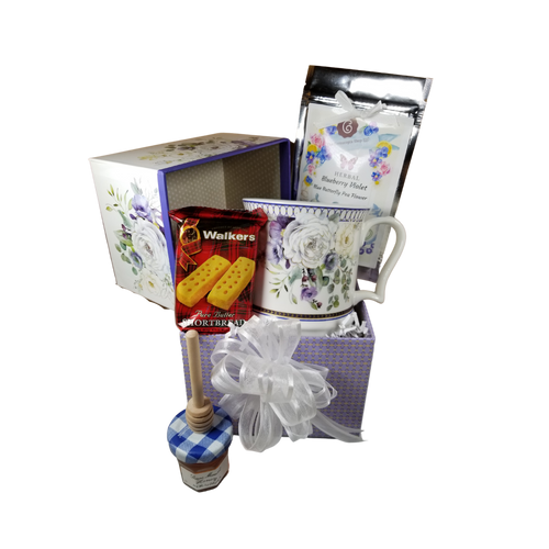 "Jumbo Coffee or Tea Mug - Purple Elegance in Gift Box, this jumbo mug is great for any beverage choice and will brighten anyone's day in its own matching print gift box with matching satin ribbon, filled with 1 oz of Cornucopia's loose-leaf Tea, mini honey, honey spool and shortbread cookie, shrink wrapped in its own giftbox as shown with decorative gift bow.  Enclosure card included with your personal message. Gifting Idea: Mother's day, Administrative Professional's Day, Birthday, Bridal party gift, Get well.  Includes:  4.2"" Porcelain Mug in gift box. Purple Elegance pattern, soft white background with a purple and white Floral print with gold accents. Dishwasher safe Mini honey honey spool  shortbread cookie 2pc 1 oz Cornucopia Tea, Blueberry Violet with Blue Butterfly Pea Flower, in a decorative package and satin bow. Resealable pouch."
