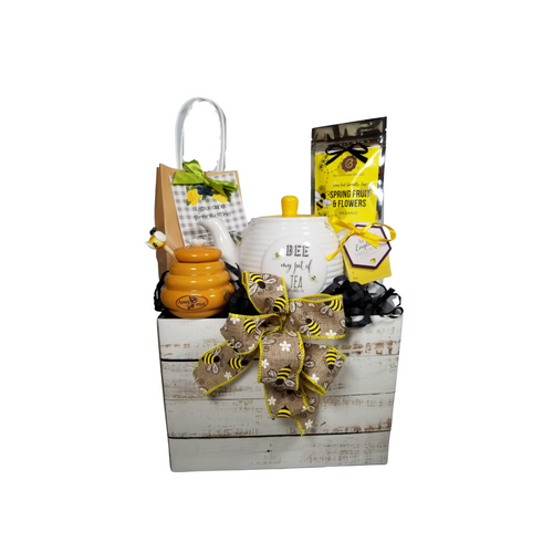 """Bee My Pot of Tea Gift Basket: Buzzing with happiness written all over it! This lovely Tea and Teapot gift set with honey pot and dipper, lemon scone mix, Cornucopia Tea is certainly mean to bee for a happy greetings just in time for tea!  16 oz. by English Teaware Company, honey and bee pattern in yellow and white with a honeycomb pattern lid. Handwash only. 1 oz of Cornucopia Shop's Organic Loose Leaf 7T6380 Spring Fruit and Flowers Honey Pot & Spool, (spool has a bee sitting on top) honey pot is a golden yellow with bee buzz print Lemon Scone Mix by the Cornucopia Shop with wording on the label """"You are simply the Zest!""""  Gift comes in a gift basket box shrink wrapped with hand made bow. Enclosure card with 10% off coupon on purchase of tea, and your personal gift message."""