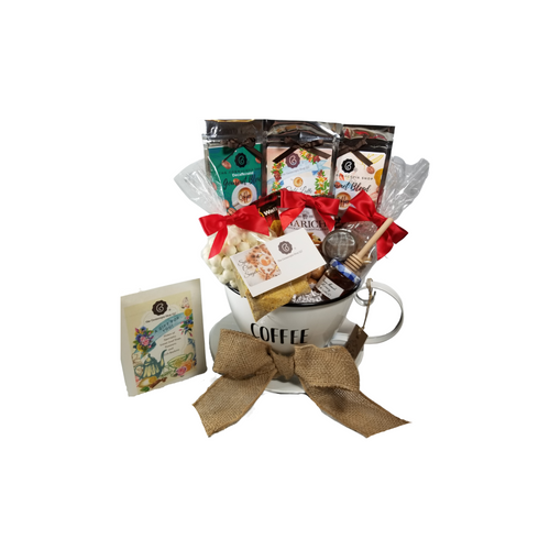 """Gourmet Coffee & Tea - Pod Holder Gift Basket: A perfect gift to set on their counter, this Coffee Pod holder holds up to 24 coffee pods after these goodies are gone. Filled with a selection of Cornucopia's Gourmet Coffee beans, Decaffeinated Gourmet Coffee Beans, and Cafe Latte Tea which is a mix of coffee beans, black tea, and chocolate! The rich decoration of creamy yoghurt pieces, a hint of cocoa, delicious, sweet chocolate, and coffee beans from our own roaster, all support the taste variety of this exquisite and unique mixture! Spicy Chai Sugar, use in tea or coffee, tea accessories for loose leaf tea making and a selection of complimentary goodies to go with either brew they choose Includes:  Coffee Pod Counter Container - White, metal container shaped like a coffee cup with the word COFFEE on the front. 1 oz. Cornucopia's Gourmet whole coffee beans, rich full roast, 1 oz Cornucopia's Gourmet Decaffeinated whole coffee beans, 1 oz of Cornucopia Shop's Organic Loose-Leaf tea 8T22441 Cafe Latte, Black tea (74 %), broken cocoa bits, brittle pieces (sugar, hazelnuts, invert sugar), Jumbo chocolate chips (sugar, ground cocoa beans with cocoa butter, cocoa powder, emulsifier: Soja lecithin), flavoring, coffee beans, freeze-dried yoghurt granules (skimmed milk yogurt, sugar, maltodextrin, modified starch, acidifying agent: citric acid) 1 oz Spicy Chai Sugar, Teaball infuser 1 1/2 """" stainless steel by Chai Cult made in Germany SKU 41519, Mini Honey 1 oz, Wood Honey Spool, 9 oz Candy Coated Pretzel Bites, 1.76 oz Marich Ginger Bites, 1.4 oz Walker Shortbread Cookies, 1 oz Chocolate Chip Cookie Bites.  Gift is wrapped in cellophane and tied with handmade bow. Enclosure card with 10% off coupon on purchase of tea, and your personal gift message."""