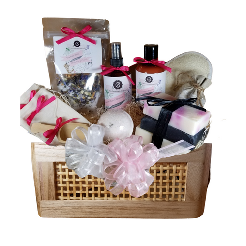 """White Tea & Cherry Bahama Spa - Gift Basket , by The Cornucopia Shop LLC: Our Bath Soaks are made of the highest quality ingredients of botanicals, Teas, Essential Oils, Dead Sea Bath Salts, Epsom Bath Salts, & Pink Himalayan Salts. Aromatherapy to lift and rejuvenate the mind. Our line includes Hand Crafted Cold Process Soaps, Body Lotions and Perfume Body Sprays, and Luxury Bath Bombs to sooth, soften and re-fresh. Dried Botanical Lingerie Sachet to scent a drawer.   Includes:  Tommy Bahama basket with rope handles 1- 4 oz White Tea & Orchid Bath Salts all-natural no dyes, 1- 8 oz Japanese Cherry Blossom Body Lotion 1- 8 oz Japanese Cherry Blossom Body Spray 1-.05 oz Super Lavender Drawer Sachet 2- Linen Bath Tea Bags(re-usable) hand wash 1- Wooden Bath Salt Scoop 1- Loofah & Terry Cloth reversible Wash Pad with Wrist Band 5 oz 2 1/2 """", Vanilla Carmael with jewel top Bath Bomb 3 Cold Process Bar Soaps, Japanese Tea Blossom, White Tea & Ginger Black Soap with activated charcoal  Gift comes shrink wrapped in reusable Tommy Bahama basket with rope handles, black paper shred fill, decorative gift bow, and enclosure gift card.  Key Ingredients:Bath Salt: Organic White Tea & Orchid loose leaf tea, Epsom Salts, White Tea and Orchid Essentail Oil. Organic Jasmine flowers, Blue Corn Flowers. Body lotion:Water, Blend of (Coconut Oil, Hempseed Oil, Sunflower Oil, Vitamin E, Mineral Oil), Propylene Glycol, Stearic Acid, Cetyl Alcohol, Phenoxyethanol, Ethylhexylglycerin, Glyceryl Stearate, Petrolatum, TEA 99%, Proprietary Fragrance and Essential Oil Blend, Dimethicone, Carbopol, Disodium EDTA, Allantoin, Aloe Vera Gel.Perfume Body Spray:Water, Ploysorbate 20, Fragrance,,DMDM Hydntoin, Disodium EDTACold Process Soaps:Olive Oil, Soybean Oil, Coconut Oil, Corn Oil. Sunflower Oil, Organic Shea Butter, Water. Sodium Hydroxide (Lye), Fragrance INCI: Olea Europaea (Olive) Oil, Glycine Soja (Soybean) Oil, Cocos Nucifera (Coconut) Oil, Zea Mays (Corn) Oil, Helianthus Annuus (Sunflower)"""