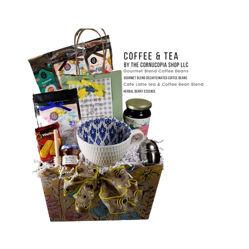 """Gourmet Morning Coffee & Tea - Gift Basket Box: This gourmet morning can start them off with tea or coffee with 2 varieties of each, lemon scone mix, shortbread cookies, mini honey, honey spool, and teaball. Great for any occasion.  Includes:  1 jumbo coffe/tea mug in white textured and navy folk print inside 1 oz. Cornucopia's Gourmet whole coffee beans, rich full roast, 9C83268 1 oz Cornucopia's Gourmet Decaffeinated whole coffee beans, 9DC83267 1 oz of Cornucopia Shop's Organic Loose-Leaf tea 8T22441 Cafe Latte, Black tea (74 %), broken cocoa bits, brittle pieces (sugar, hazelnuts, invert sugar), Jumbo chocolate chips (sugar, ground cocoa beans with cocoa butter, cocoa powder, emulsifier: Soja lecithin), flavoring, coffee beans, freeze-dried yoghurt granules (skimmed milk yogurt, sugar, maltodextrin, modified starch, acidifying agent: citric acid) 1 oz of Cornucopia Shop's Organic Loose-Leaf tea Strawberry Essence 7T6394 Organic black tea, organic hibiscus, natural strawberry flavor and organic rose petals. Teaball infuser 1 1/2 """" stainless steel by Chai Cult made in Germany SKU 41535, Mini Honey 1 oz, Wood Honey Spool, Lemon Scone Mix 11 oz Cornucopia's Gourmet Blueberry Jam 1.4 oz Walker Shortbread Cookies,  Gift is wrapped in cellophane and tied with handmade bow. Enclosure card with 10% off coupon on purchase of tea, and your personal gift message."""