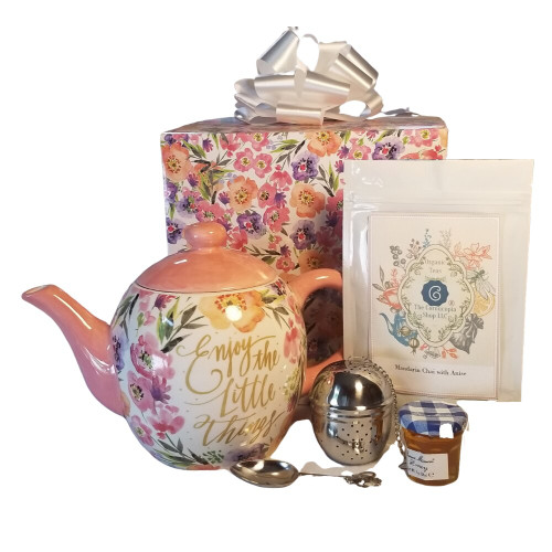 """Enjoy the little things! Tea Pot: A lovely way to send someone a smile to bright their day, say happy birthday, or let them know your thinking of them. Porcelain, holds 16 oz. Comes in it's own matching print gift box and giftwrapped with a satin bow.  Includes:  16 oz porcelain Teapot, pink floral print with the statement Enjoy the little things! Dishwasher/microwave safe,FDA food approved 1 oz off Cornucopia's Strawberry Essence Loose Leaf Tea 7T6394: Strawberry Essence (Loose Leaf) combines organic black tea with a splash of sweet strawberry nuance. Ingredients: Organic black tea, organic hibiscus, natural flavor and organic rose petals.  Teaball infuser w/drip catcher 41535 stainless steel, 1"""" ball Mini honey 1 oz jar  Wood honey spool Tea measuring spoon/Teapot handle stainless stell for perfect cup of tea  This gift comes in a pink floral box with a white or teal satin bow. Tea and accessories come in a paper gift bag with hanlde and decorative hand tied bow. Enclosure gift card with your personal message is attached to the gift bag."""