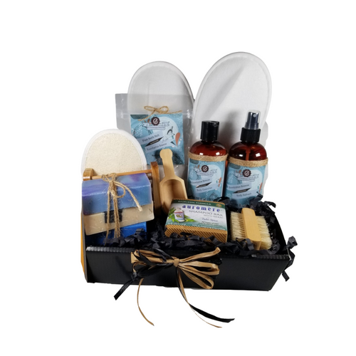 Men's Eucalyptus Breeze Spa - Gift Basket Tray by The Cornucopia Shop LLC: a luxury spa gift just for him. Our line includes Hand Crafted Cold Process Soaps in complimentary scents, Body Quenchers to soften skin, and Body Refresher Sprays, to use anytime for a cooling mist with a light scent he'll love. 8 ounces of foot soak to ease, sooth and refresh tired feet. Can also be used in the tub for an overall body rejuvenation. This gift also includes a natural fiber nail brush, a bamboo and wood soap saver tray, and wood scoop for the perfect measure of foot soak. A one size fits most spa slipper he can slip into after enjoying his soak.    Includes:  1- 8 oz Eucalyptus Breeze Foot Soak, no dyes, 1- 8 oz Eucalyptus Breeze Body Quencher Lotion 1- 8 oz Eucalyptus Breeze Body Refresh Spray 1- Wooden Bath Salt Scoop 1- Natural double bristle sided Nail Brush by Ecolather 1- Natural Soap Saver Bamboo and Wood Tray by Ecolather 1- Loofah & Terry Cloth reversible Wash Pad with Wrist Band 1- Spa Slipper, White, one sizes fits most` 1-Shampoo Bar with Neem, Ayurvedic formula by Auromere (Vata-Pitta-Kapha) 3 Cold Process Bar Soaps, Bondi Breeze (Light citrus mixed with hints of jasmine, rose and hyacinth with musky base.) Dead Sea Mud (Musky earthy fragrance with amber and green base notes. Contains activated charcoal, sea salt, and various clays as exfoliants.) Cool Spring Scrub (Fresh clean manly fragrance. Comparable to Irish Spring or another men's type bar soap. Contains sea salt as an exfoliant.)  Gift comes shrink wrapped in reusable gift storage tray paper shred fill, hand tied bow, and enclosure gift card with your personal message.  Key Ingredients: Foot Soak: Foot Soak: Epsom Salts, Pink Himalayan Salt, Dead Sea Salt, Eucalyptus Essential Oil, Spearmint Essential Oil, Benzyl Benzoate, Benzyl Salicylate, Limonene, Linalool. White Tea and Orchid Essential Oil. All natural no dyes. Body Quencher Lotion: Water, Blend of (Coconut Oil, Hempseed Oil, Sunflower Oil, Vitamin E