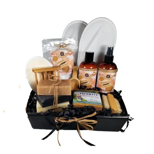 Men's Oatmeal & Honey Spa - Gift Basket Tray by The Cornucopia Shop LLC:  a luxury spa gift just for him.  Our line includes Hand Crafted Cold Process Soaps in complimentary scents, Body Quenchers to soften skin, and Body Refresher Sprays, to use anytime for a cooling mist with a light scent he'll love. 8 ounces of foot soak to ease, sooth and refresh tired feet. Can also be used in the tub for an overall body rejuvenation.  This gift also includes a natural fiber nail brush, a bamboo and wood soap saver tray, and wood scoop for the perfect measure of foot soak. A one size fits most spa slipper he can slip into after enjoying his soak.      Includes:  •1- 8 oz Oatmeal & Honey Body Quencher Lotion •1- 8 oz Oatmeal & Honey Body Refresh Spray •1- 8 oz Eucalyptus Breeze Foot Soak, no dyes,  •1- Wooden Bath Salt Scoop  •1- Natural double bristle sided Nail Brush by Ecolather •1- Natural Soap Saver Bamboo and Wood Tray by Ecolather •1- Loofah & Terry Cloth reversible Wash Pad with Wrist Band •1- Spa Slipper, White, one sizes fits most •1- Shampoo Bar with Neem, Ayurvedic formula by Auromere (Vata-Pitta-Kapha) •3 Cold Process Bar Soaps, oOatmeal Spice (Delightful, sweet oatmeal with a robust base note.) oBlack Soap (Oakmoss and aloe top notes with light floral undertones. Contains activated charcoal) oBay Rum (Cloves, cinnamon, patchouli, pine, musk and vanilla with top notes of orange and apple.) Gift comes shrink wrapped in reusable gift storage tray paper shred fill, hand tied bow, and enclosure gift card with your personal message. Key Ingredients: Foot Soak: Foot Soak: Epsom Salts, Pink Himalayan Salt, Dead Sea Salt, Eucalyptus Essential Oil, Spearmint Essential Oil, Benzyl Benzoate, Benzyl Salicylate, Limonene, Linalool. White Tea and Orchid Essential Oil. All natural no dyes. Body Quencher Lotion: Water, Blend of (Coconut Oil, Hempseed Oil, Sunflower Oil, Vitamin E, Mineral Oil), Propylene Glycol, Stearic Acid, Cetyl Alcohol, Phenoxyethanol, Ethylhexylglycerin, Glyc