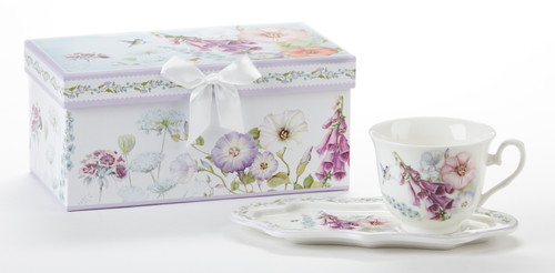"""Bell Isle Tea and Toast Set in Gift Box: Enjoy your morning breakfast or afternoon tea and snack on this pretty set. A pleasant way to create a moment of indulgence. Add one of our specialty loose leaf teas and cuddle up with a good book, sounds invigting to whisk your cares away. Meant for everyday use. Comes in its own matching print gift box with matching satin ribbon. Great Gift Idea: New Mommy, Birthday, get well, thank you.  Includes:  4.2"""" x 9"""" tray Porcelain Teacup Soft white background with Bell Isle pattern in purple, green and white floral print Dishwasher safe  Other Items Available:  Gift Set, Pamper me Gift Box: wonderful for New Mom, Bridal, Specail someone see SKU:GSD97421 Tea choices available to add to your order in the loose-leaf shop Teas and Teaware are shipped together, Cornucopia Teas come in resealable pouches with decorative tea labels, and includes a recipe and brewing guide. If purchasing as a gift your personal message is included on the pamphlet."""