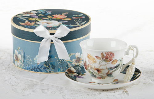 """English Camellia Cup/Suacer,will brighten anyone's day with this beautiful tea set gift in its own navy and teal flower print gift box with matching satin ribbon. A decorative tassel on the handle adds a lovely finishing touch. Gifting Idea: birthday gift, bridal shower, get well, treat yourself or someone you love.  Includes:  3.5"""" Cup/Saucer in gift box Soft white background with navy and teal floral print Dishwasher safe  Other Items Available:  Matching Teapot available D8150-4  Tea choices available to add to your order in the loose-leaf shop  Teas and Teaware are shipped together, Cornucopia Teas come in resealable pouches with decorative tea labels, and includes a recipe and brewing guide. If purchasing as a gift your personal message is included on the pamphlet."""