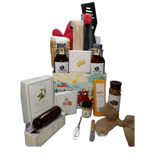 """BBQ Gourmet Gift Basket: A gourmet treats and essentials for summer BBQs. Get them off to a good start with 2 gourmet BBQ sauces, Pepper Steak Spice Rub, use on steaks or hamburger patties. Gourmet treats to enjoy include, chedear cheese brick, Jalepeno Cheese brick, gourmet crackers, beef summer sausge log, gourmet spicy mustard, Popcorn and much more! Includes long handled basting brush, Cabob screwers, grill mit, and metal long handled spatula with serated edge.  Includes:  BBQ Gourmet Gift Basket: A gourmet treats and essentials for summer BBQs. Get them off to a good start with 2 gourmet BBQ sauces, Pepper Steak Spice Rub, grilling tools, and mitt, and personal gifts for the cook to enjoy such as, cheddar cheese brick, jalapeno cheese brick, gourmet crackers, beef summer sausage, gourmet spicy mustard, Popcorn and much more!  Includes:  Reusable gift box to organize BBQ tools, Cookbooks Basting Brush, 14"""" long handle, silicone, BBQ Spatula with serrated edge, 14"""" long handle, Bamboo Skewers,100 ct. for kabobs, Grilling mitt, Mini Cheese Spreader, 19 oz The Cornucopia's Gourmet Texas Style BBQ sauce, 19 oz The Cornucopia's Gourmet Memphis Style BBQ sauce, 5 oz Hardwood Smoked Summer Sausage, 2 oz Gourmet Amber Beer Mustard, 2 oz Garlic and Cheese dip/spread mix. As an extra grilling treat – mix and spread on sourdough or French bread slices and grill. HEAVY garlic made especially for garlic lovers! Mini Whisk, Slim Jim, original smoked snack stick, 8 oz Cheddar Cheese bar 7"""" tall x ¾ """"thick, 4 oz Olive Oil & Sea Salt Crackers, GMO free boxed 7"""" Hx5"""" Wx2.125D, 4 oz bagged Vanilla Caramel Popcorn 9"""" tall x 2.5"""" D,  Gift comes wrapped in cellophane with hand tied burlap bow, a complimentary enclosure card with your personal message."""