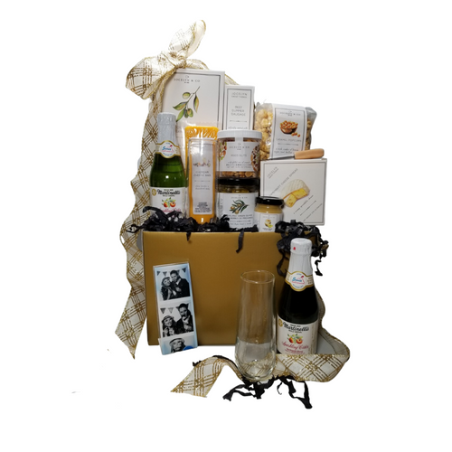 """Wedding Greetings Gift Basket Box: Send them off with a gift of treats from the Cornucopia's Epicure Shop, with an array of Cheeses, Hardwood Smoked Summer Sausage, Gourmet Crackers, Mixed Nuts, Vanilla Caramel popcorn, and much more in this party for two celebration box. * Gourmet Food products are made in the USA and are shelf stable.  Includes:  Reusable gift box Gold, Photo Booth Frame, 2 x 6 acrylic, 2- Champagne Flutes Stemless, 2- 8.4 oz Martinelli's Sparkling Apple Juice, Mini Cheese Spreader, *5 oz jar Sevillano Green Olives with Herbes de Provence (basil, thyme, fennel, and lavender) *3.75 oz Camembert Cheese Spread 4""""H x 4""""Wx x1""""D *2 oz Gourmet Amber Beer Mustard, *5 oz Hardwood Smoked Summer Sausage, *8 oz Cheddar Cheese bar 7"""" tall x ¾ """"thick,  4.75 oz Mixed Nuts, delightful mix of crunch,  4 oz bagged Vanilla Caramel Popcorn 9"""" tall x 2.5"""" D, *4 oz Olive Oil & Sea Salt Crackers, GMO free boxed 7"""" Hx5"""" Wx2.125D,  Gift comes wrapped in cellophane with Gold and White Glitter hand tied bow, a complimentary enclosure card with your personal message."""