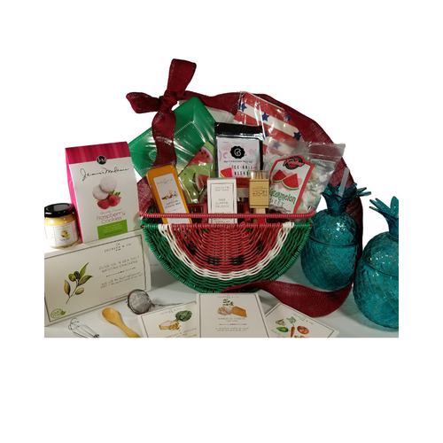 """Watermelon Tabletop Organizer Gift Basket: We found the cutest picnic tabletop organizer by C & C California Home outdoor entertaining ware. This watermelon utensil and plate holder comes pre-stocked with picnic fair and gourmet treats from the Cornucopia Epicure Shop. Other whimsies include 2-Pineapple shaped tumblers with straw, Grab food or basket liner/wraps, watermelon paper napkins, birch picnic forks with red sparkle handle, green paper plate and wood condiment spoon, watermelon mint tea Iceable blend, by the Cornucopia Tea Shop, infuser.  *Gourmet Food products are made in the USA and are shelf stable.  Includes:  Watermelon Tabletop Organizer by C & C California Home, outdoor entertaining, 2 Blue Pineapple Tumblers with Straw, Mini Wood Condiment Spoon, Mini Whisk, & three 1 oz Gourmet Dip Mixes, Garlic & Cheese, Rustic Vegetable, Parmesan & Artichoke All American Grub Wrap Papers, by Eat Drink Host, grease proof paper basket liner, food wrap. 12 ct. food safe. Watermelon Print luncheon Napkins 20 ct. Large Café Plates 8 ct. Eat Drink Host - Red Sparkle Birch Forks 12 pcs Tea Ball Infuser 1"""" stainless steel by Cha Cult 1 oz Fruit Tea Blend, flavored Watermelon/Mint by the Cornucopia Tea Shop A much loved summer combo: refreshing and wonderfully cooling, with a generous helping of melon cubes and flakes. A real pleasure served cold. Ingredients: apple pieces, Honeydew melon (melon, sugar, fructose-syrup), hibiscus blossoms, elderberries, peppermint (9%), flavoring, rose hip peel, watermelon flakes. *4 oz Forbes Old Fashion Saltwater Watermelon Taffy *2 oz Gourmet Amber Beer Mustard, *5 oz Hardwood Smoked Summer Sausage, *8 oz Cheddar Cheese bar 7"""" tall x ¾ """"thick, *4 oz Olive Oil & Sea Salt Crackers, GMO free boxed 7"""" Hx5"""" Wx2.125D  Gift comes wrapped in cellophane with a hand tied bow and a complimentary enclosure card with your personal message."""