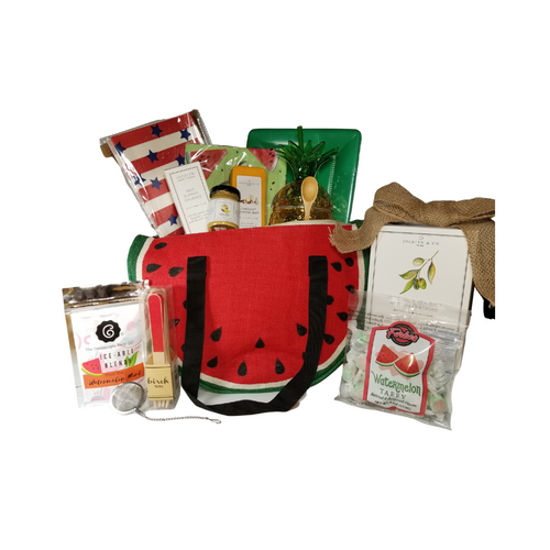 """Watermelon Cooler Bag Gift Basket: We found the cutest summer cooler bag and filled it with mouthwatering watermelon treats, picnic ware and gourmet fare from the Cornucopia's Epicure Shop. The watermelon cooler bag by Natural Elements is insulated to keep your items chilled. Other whimsies include a Pineapple shaped tumbler with straw, Grab wraps for sandwiches and cakes, watermelon paper napkins, birch picnic forks with red sparkle handle 12pcs., green paper plate and wood condiment spoon, watermelon mint tea Iceable blend, by the Cornucopia Tea Shop, infuser.  *Gourmet Food products are made in the USA and are shelf stable.  Includes:  Watermelon Cooler Bag by Natural Elements, Yellow Pineapple Tumbler with Straw, Mini Wood Condiment Spoon, All American Grub Wrap Papers, by Eat Drink Host, grease proof paper basket liner, food wrap. 12 ct. food safe. Watermelon Print Luncheon Napkins 20 ct. Large Café Plates 8 ct. Eat Drink Host - Red Sparkle Birch Forks 12 pcs Tea Ball Infuser 1"""" stainless steel by Cha Cult 1 oz Fruit Tea Blend, flavored Watermelon/Mint by the Cornucopia Tea Shop A much loved summer combo: refreshing and wonderfully cooling, with a generous helping of melon cubes and flakes. A real pleasure served cold. Ingredients: apple pieces, Honeydew melon (melon, sugar, fructose-syrup), hibiscus blossoms, elderberries, peppermint (9%), flavoring, rose hip peel, watermelon flakes. *4 oz Forbes Old Fashion Saltwater Watermelon Taffy *2 oz Gourmet Amber Beer Mustard, *5 oz Hardwood Smoked Summer Sausage, *8 oz Cheddar Cheese bar 7"""" tall x ¾ """"thick, *4 oz Olive Oil & Sea Salt Crackers, GMO free boxed 7"""" Hx5"""" Wx2.125D  Gift comes with all the gourmet goodies and gifts tucked inside the watermelon cooler bag, with a hand tied bow and a complimentary enclosure card with your personal message."""