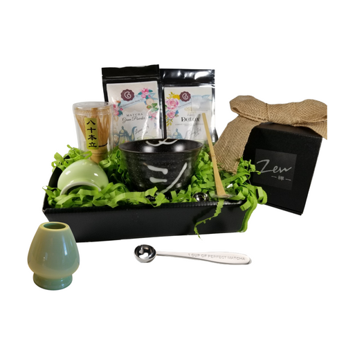 """Inner Healing Teas Gift Tray: This gift is perfect for the health-conscious. Comes with two varieties of loose-leaf teas. A Detox tea, and Green Tea Matcha powder. Come with everything required to master making Matcha tea, including a recipe guide.  Includes:  1 oz of Cornucopia's Matcha Green Tea Powder: an organic culinary-grade green tea powder. Carries a creamy, non-bitter, vegetal flavor profile. Unlike regular green tea, where the leaves are removed after being brewed, Matcha Green Powder is stone ground into a fine powder (from the leaves) and meant to be whisked with water and consumed entirely, hence ensuring almost 10-times higher concentration of antioxidants, polyphenols, vitamins and minerals. This culinary-grade Matcha Green Powder is meant for making smoothies, shakes, lattes, cocktails and cooking, and is the grade of matcha that you would commonly drink in coffee shops or cafés. 1 oz of Cornucopia's organic Ayurvedic Infusions Detox Loose Leaf Tea: aims to establish a balance of immunity, inner peace and physical rejuvenation, allowing one's prakriti to heal and start anew.* Ingredients: Organic lemongrass leaf, organic echinacea purpurea herb, organic licorice root, organic dandelion root, organic peppermint leaf, organic Tulsi leaf and organic ginger root. Zen Matcha Bowl (Kimi), Matcha Whisk (Chasen), Matcha Bamboo Spoon (Momoka), Porcelain Matcha Whisk Holder (Ingolf), Matcha Measuring Spoon engraved with """" 1 Cup of Perfect Matcha""""  This gift comes wrapped in cellophane and topped with a handmade bow. A complimentary Gift Card with your personal message. *Information on Ayurvedic Infusions (Wellness) Loose Leaf Teas."""