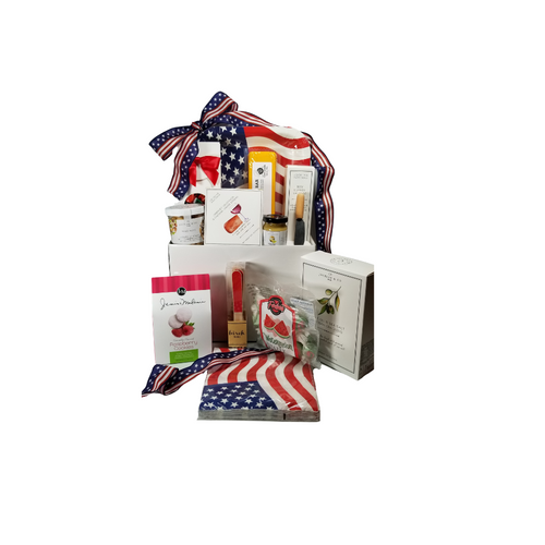 """I Love the USA - Patriotic Gift Basket Box: From the Cornucopia's Epicure Shop, a patriotic bundle of treats and party fare, with gourmet specialties proudly made in the USA. Perfect to send for any occasion. An array of cheeses, Hardwood Smoked Summer Sausage, Gourmet Crackers, Mixed Nuts, Specialty Cookies, and Hard Candies.  *Gourmet Food products are made in the USA and are shelf stable.  Includes:  Reusable gift box USA Flag Paper Plate, 12, 9 x 9, USA Luncheon Paper Napkin, 18 13 x 13, Eat Drink Host - Red Sparkle Birch Forks Set of 12 disposable birch forks Mini Cheese Spreader, *2 oz Gourmet Amber Beer Mustard, *5 oz Hardwood Smoked Summer Sausage, *8 oz Cheddar Cheese bar 7"""" tall x ¾ """"thick,  4.75 oz Mixed Nuts, delightful mix of crunch, *3.75 oz Cabernet Sauvignon Cheddar Cheese Spread, a creamy spreadable cheese made with real, cabernet sauvignon wine, and cheddar cheese. Size: 4Hx4Wx1D, 4 oz bagged Watermelon Taffy by Forbes Old Fashioned,  4 oz boxed Strawberry flavored hard candy by Coastal Bay®, * 2.5 oz boxed J & M Gourmet Tea Cookies, Raspberry, Lemon, or Lime, naturally flavored, 4 oz Olive Oil & Sea Salt Crackers. Made with the finest cold-pressed EVOO plus the perfect pinch of sea salt. GMO Free.  Gift comes wrapped in cellophane with hand tied American Flag bow, a complimentary enclosure card with your personal message."""