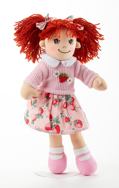 """14"""" Apple Dumplin Strawberry Bell Doll: She's all dressed up in her prettiest play dress in strawberry print, pink shoes and matching sweater and ribbon in her hair. A perfect tea party companion.  She's just waiting to be invited to Tea!  Includes:  1 14"""" Apple Dumplin Doll"""