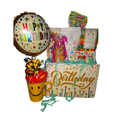"""Happy Birthday Wishes Gift Box: Comes with a personal goody party of gourmet cookies, candy, Jelly Belly Jellybeans, Fruity flavored gourmet popcorn. In a mug Cake Mix, Smiley Mug, Birthday Balloon. Mug comes filled with a variety of traditional name brand hard candy.  Includes:  Smiley Mug and 9"""" air-filled , ribbon curls Birthday Balloon, filled with a mix of name brand candy, Starburst, SweetTarts, Tootsie Roll, Jolly Rancher Skittles, Nerds, LaffyTaffy, or Tootsie Fruit Chews. 4 oz Birthday Vanilla Mug Cake, sweet & fruity with a touch of bubbly, microwaveable birthday cake in a mug! Jelly Belly Jellybeans mini with assorted flavors 2.5 oz Sugar Cookies, crunchie sweet Cotton Candy Drops boxed Happy Birthday Box Carnaval Lollies, assorted flavors, for the young at heart *4 oz bagged Fruity Gourmet Popcorn 9"""" tall x 2.5"""" D,  Gift comes wrapped in cellophane, matching ribbon, and paper shred fill. A complimentary gift card with your personal message."""
