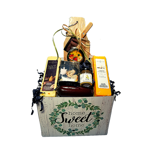 """Congratulations New Home Gift Box: From Cornucopia's Epicure Shop, a showcase of gourmet specialties and gifts ideal Starting with the Paddle Cutting Board and Clever, to the assorment of Shelf-stable, Cheeses, Summer Sausage, Gourmet Crackers, (by Jocelyn & Co), and Rendezvous Tin of assorted fruit flavored hard candy. simply delicious gift.   Gifting Ideas: for a new home for friends, family, coworker, or employee. Great Realtors appreciation gift.  Includes:  Reusable Gift Box Paddle Cutting Board Stainless Steel Cleaver, *2 oz Gourmet Amber Beer Mustard, *5 oz Hardwood Smoked Summer Sausage, *8 oz Jalapeno Monterey Jack Cheese bar 7"""" tall x ¾ """"thick, *8 oz Cheddar Cheese bar 7"""" tall x ¾ """"thick, 5 oz Rendezvous Tin of assorted fruit hard candy drops 3 oz Bruschetta Parmesan Crips,  *Gourmet Food products are made in the USA and are shelf stable.  Gift comes wrapped in cellophane with hand tied Red and White Plaid bow, a complimentary enclosure card with your personal message."""