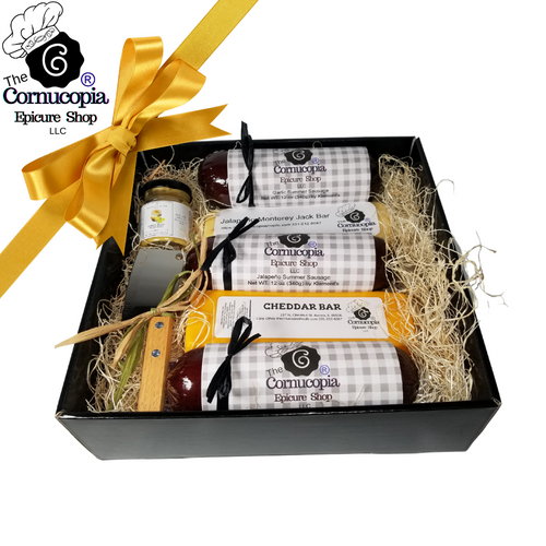 """Cornucopia's Jumbo Meat & Cheese Tray: From Cornucopia's Epicure Shop, a showcase of gourmet meats and cheese specialty wrapped for gift giving with our signature Cornucopia Epicure Shop wrappers. This tray comes with three, full sized, 12 oz hardwood smoked summer sausage, in Garlic, Cheddar and Jalapeno. 2 8 oz cheese bars, Cheddar and Jalapeno, amber ale mustard and a stainless-steel cleaver.  Includes:  Stainless Steel Cleaver, *2 oz Gourmet Amber Beer Mustard, * Specialty gift wrapped meat n cheese items: *3-12 oz Hardwood Smoked Summer Sausage, by Klement's Garlic Jalapeno Cheddar *8 oz Cheddar Cheese bar 7"""" tall x ¾ """"thick by Jocelyn & Co. *8 oz Jalapeno Monterey Jack Cheese bar 7"""" tall x ¾ """"thick, by Jocelyn & Co.  *Gourmet Food products are made in the USA and are shelf stable. Refrigerate after opening.  Gift comes in a 10"""" x 10"""" x 3"""" tray, wrapped in cellophane with Matching Ribbon & Shred Fill, a complimentary enclosure card with your personal message."""