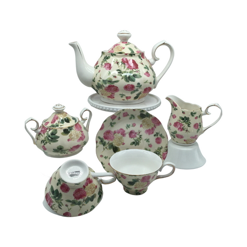 Grace Teaware Rose Chintz Bouquet Tea Set Gift Boxed 11pc porcelain Grace Tea set in a Rose chintz with yellow background and white with gold trim. Beautiful and easy to incorporate into any table decor. Complete service for 4. Teapot holds 5 cups. Matching cream and sugar bowl. To be enjoyed for years to come.  Gifting Idea: birthday, bridal shower, or Mother's Day. treat yourself or someone you love!  Includes:  11 pc porcelain tea set by Grace Teaware 1- 5 cup Teapot 4 - cup/saucer set 1 - Cream/sugar set White background with rose chintz print on a pale yellow background, gold trims Dishwasher safe  Enclosure card included.